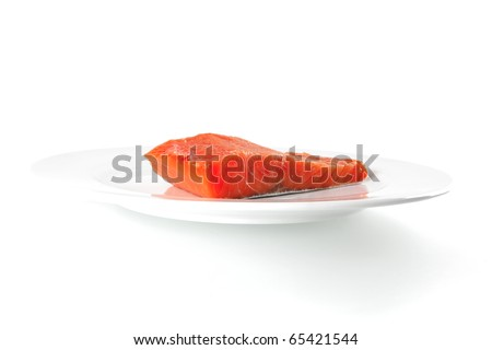 smoked pink salmon chunk on a big white dish