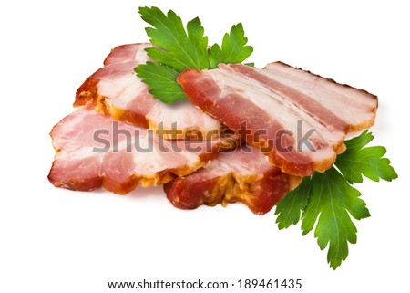 Smoked pork brisket and green leaves of parsley on a white background - stock photo