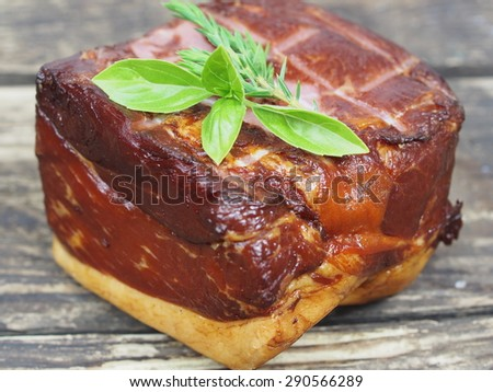 smoked pork with rosemary  - stock photo