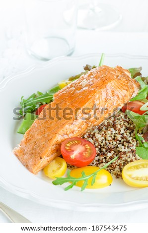 Smoked salmon and colorful quinoa salad with cherry tomatoes and