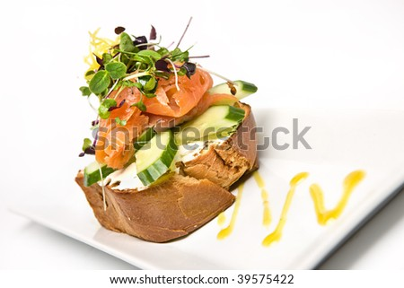 Smoked salmon and salad on cream cheese toast - stock photo