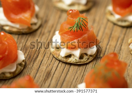 Smoked Salmon Canapes with sprigs of dill and cream cheese - stock photo