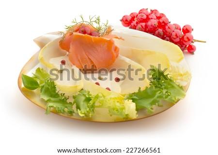 smoked salmon, chicory salad and cream sauce - stock photo