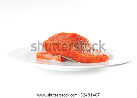 smoked salmon chunk on a big white plate