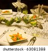 Smoked salmon dish on a festive table with flower arrangement - stock photo