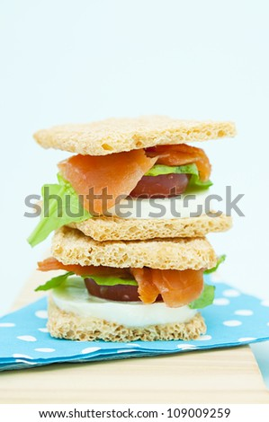 smoked salmon, mozzarella cheese and tomato cracker sandwich