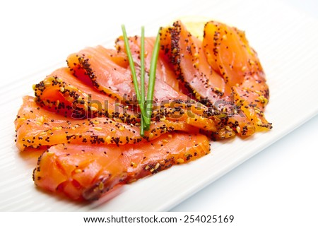 smoked salmon on white dish with chive - stock photo