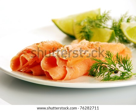 smoked salmon on white plate with herbs and lime