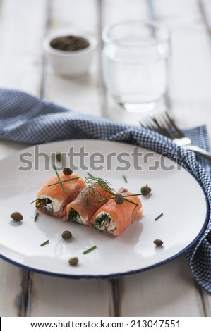 Smoked salmon rolls with cheese - stock photo