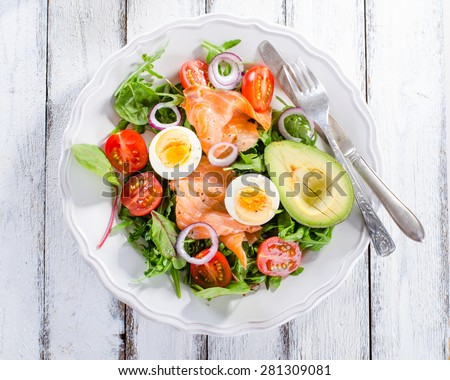 Smoked salmon salad with greens, tomatoes, eggs and avocado - stock photo