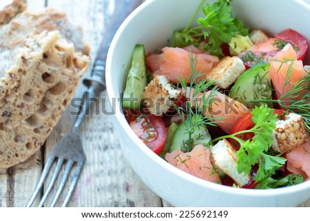 Smoked salmon salad with vegetables and fresh herbs