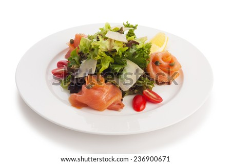 Smoked salmon served with asian mix salad, shallot and balsamic dressing, isolated on white. - stock photo