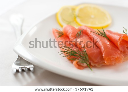 Smoked salmon with dill and lemon - stock photo