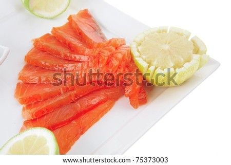 smoked salmon with lemon and hot green sauce