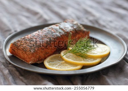 Smoked salmon with slices of lemon and dill. - stock photo