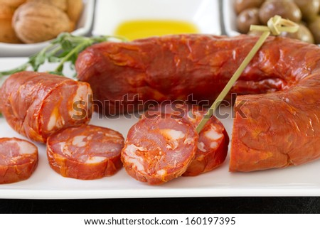 smoked sausages with olives and oil - stock photo