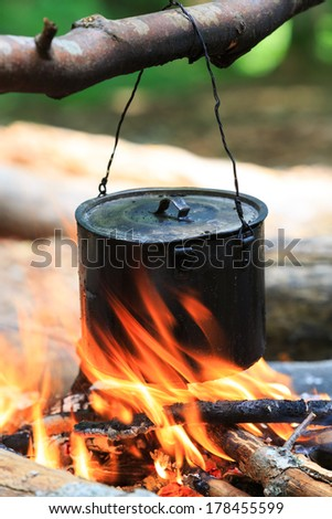 smoked tourist kettle on fire - stock photo