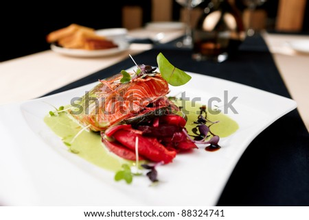 Smoked trout with vegetables on a plate - stock photo