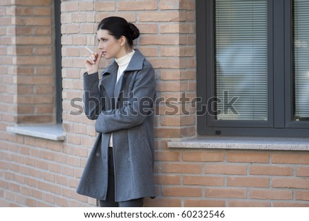 Smoker outside the office - stock photo