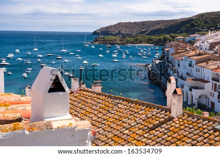 Smokestack and rooftops at Cadaques bay - Spain - stock photo