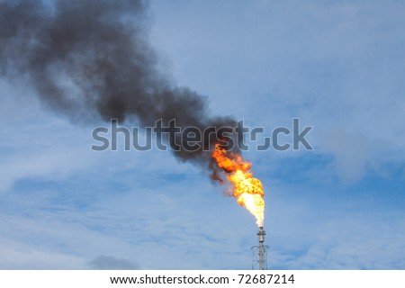 Smokestack draining fuel and gas into the are caused by error in the productions systems these may be pollution and global warming situation of the planet - stock photo