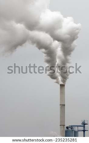 Smokestack of a factory in Zaragoza province, Aragon, Spain - stock photo