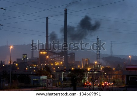 Smokestacks in factory at dawn. Horizontal view of heavy industry at dawn near Gij�³n, Asturias, North Spain