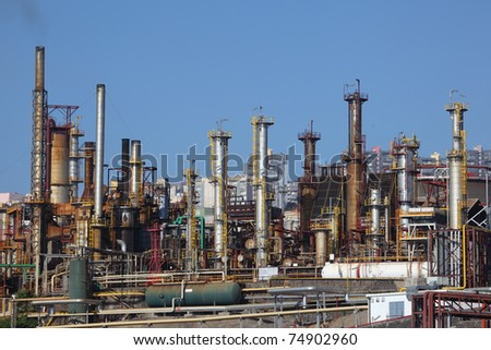 Smokestacks of an oil refinery plant - stock photo