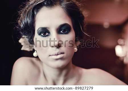 Smokey makeup girl - stock photo