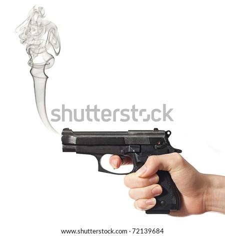 Smoking black gun after shooting. - stock photo