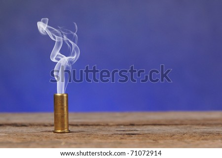 Smoking bullet on old vintage wood table with copy space - stock photo