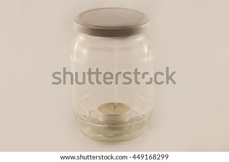 Smoking candle in a closed jar