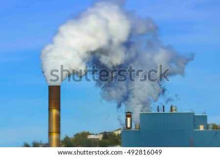 Smoking chimney - industrial pollution / selective focus