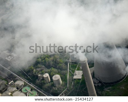 Smoking chimney of a power plant, aerial view