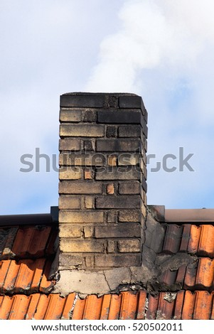 Smoking Chimney of an Old House