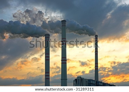 smoking chimney of chemical factory - stock photo
