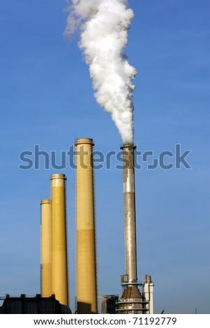 smoking chimney of coal power plant - stock photo
