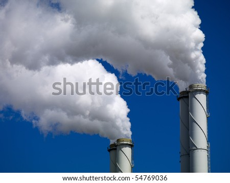 Smoking chimneys in industrial area