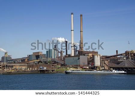 Smoking chimneys of Tata Steel industries in IJmuiden, Holland - stock photo
