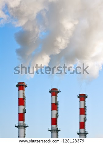 Smoking chimneys polluting the environment - stock photo