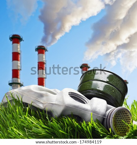 Smoking chimneys polluting the environment of the planet earth - stock photo