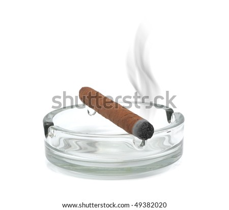 Smoking cigar in an ashtray. Isolated on a white background - stock photo