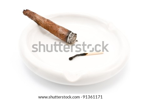 Smoking cigar in an ashtray isolated on  white - stock photo