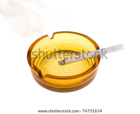 Smoking cigarette in an ashtray - stock photo