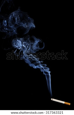 Smoking Cigarette isolated on Black Background. Close up with White Cigarette Smoke. Copy Space for Text or Image - stock photo