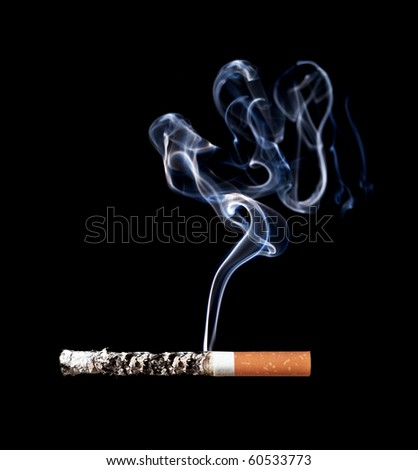 Smoking cigarette. Isolated on black. Closeup. - stock photo
