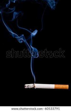 Smoking cigarette. Isolated on black. Closeup. - stock photo