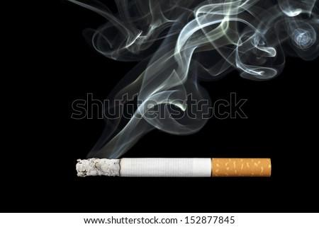 smoking cigarette on black background - stock photo