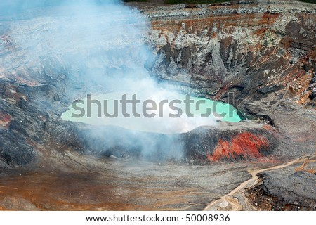 Smoking crater of Poas volcano, Costa Rica. - stock photo