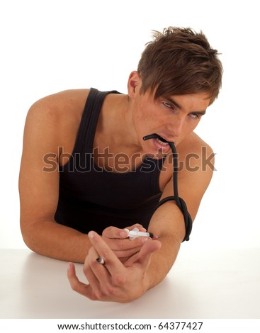 smoking drug addict young man in action - stock photo
